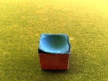 Snooker chalk close up on green flannel pool table background. royalty free stock photo