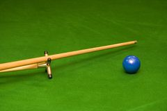 Snooker Cue and ball. Snooker on rest with blue ball Stock Photo