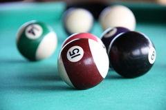 Snooker. Is a cue sport that is played on a green or other coloured baize-covered table with pockets in each of the four corners and in the middle of each of Royalty Free Stock Photo