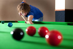 Snooker long shot. Snooker player taking a long shot across the table royalty free stock photo