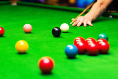 Snooker - man aiming the cue ball Stock Images