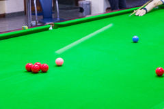 Snooker is moving. White Snooker is moving towards the Red Snooker Royalty Free Stock Photos