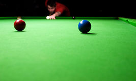 Snooker Player. Taking aim at the snooker table Royalty Free Stock Image
