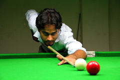 Snooker Player. Playing snooker with great concentration stock photo