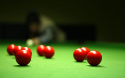 Snooker player. Hitting a ball, shallow depth of field royalty free stock image