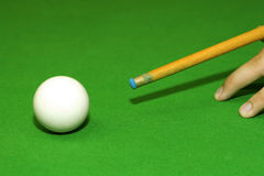 Snooker player. Hitting a ball, shallow depth of field royalty free stock photography