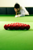Snooker player. Hitting a ball, shallow depth of field Stock Photos