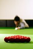 Snooker player. Hitting a ball, shallow depth of field Stock Images
