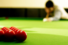 Snooker player. Hitting a ball, shallow depth of field Royalty Free Stock Photo