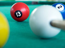 Snooker. Player hitting a ball, shallow depth of field royalty free stock image