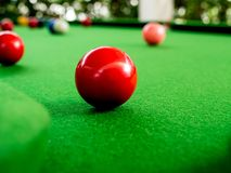 Snooker. Red and Colorful Snooker Balls Near Corner Hole on Green Snooker Table stock photography