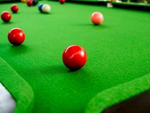 Snooker. Red and Colorful Snooker Balls Near Corner Hole on Green Snooker Table stock photos