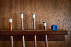 Snooker Sticks. Four Snooker sticks and blue chalk royalty free stock image