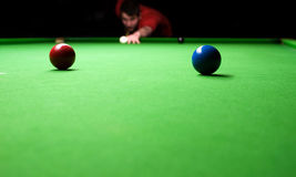 Snooker table. Man taking his shot on a Snooker table Royalty Free Stock Photo