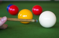 Snooker table. With red, white and yellow snooker balls stock photo