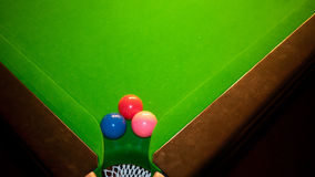 Snooker table with three balls in the corner. Three snooker balls near the hole in the corner of a snooker billiards table Royalty Free Stock Image