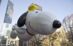 Snoopy with Woodstock on his back. NEW YORK CITY, NY - NOVEMBER 28 : Snoopy and Woodstock, from Peanuts, flying through W 59th ST during the Macy's 87th Annual Royalty Free Stock Photo