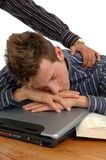 Snooze. A man caught sleeping on the job Stock Image