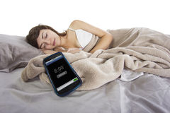 Snooze. Female snoozing modern cell phone alarm clock Royalty Free Stock Photography