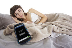 Snooze. Female snoozing modern cell phone alarm clock Royalty Free Stock Photo