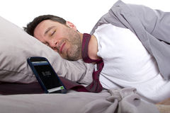 Snoozing Alarm. Tardy employee unable to wake up in time to get to work Stock Image