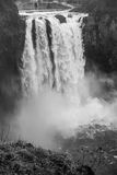 Snoqualmie Falls BW. Snoqualmie Falls in Washington State on a powerful day. Water blasts over the edge creating a massive rising mist. Black and white photo Royalty Free Stock Image