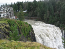 Snoqualmie Falls and the Lodge. Flood waters swell Snoqualmie Falls, located in Washington State stock images