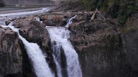 Snoqualmie falls and waterfall at its rocky top stock video footage