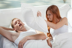 Snoring boy and his girlfriend Royalty Free Stock Image
