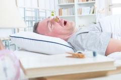 Snoring man in bed Stock Photography