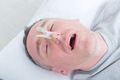 Snoring man in bed Stock Image