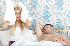 Snoring man and frustrated woman. Woman trying to sleep while men snoring Stock Images