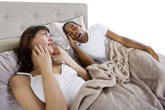Snoring. Unable to sleep in bed because of snoring partner Stock Image