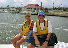 Snorkel Couple on a Boat. A couple is transported to a snorkel dive on a boat Royalty Free Stock Photos