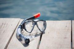 Snorkel equipment in front of water Stock Image