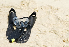 Snorkel equipment on a tropical sandy beach Royalty Free Stock Images