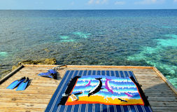 Snorkel and fin on terrace of luxury water villa. Maldives Royalty Free Stock Images