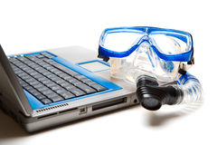Snorkel and laptop Stock Images