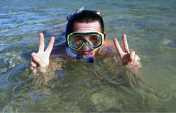 Snorkel man. A young man with snorkel and mask at the sea Royalty Free Stock Photography