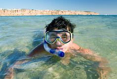 Snorkel man. A young man with snorkel and mask at the sea Stock Photography