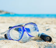 Snorkel and mask on the beach. Royalty Free Stock Photography
