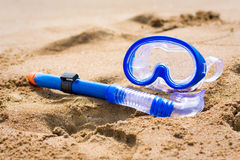 Snorkel and mask on beach Royalty Free Stock Image