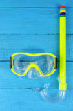 Snorkel and mask for diving  on blue wooden background Royalty Free Stock Image