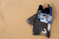 Snorkel Mask & Flippers on Sand at Beach Royalty Free Stock Photo