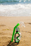 Snorkel and mask in sand Stock Images