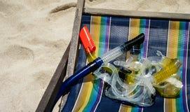 Snorkel maska ustawiająca na plażowym krześle Obrazy Royalty Free
