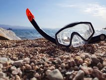 Snorkel and scuba mask on the beach royalty free stock photo