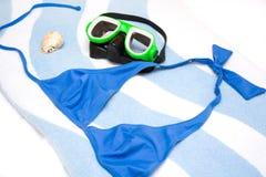 Snorkel, shell and bikini Royalty Free Stock Photos
