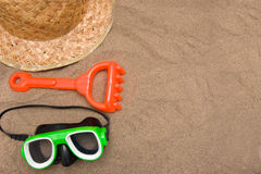 Snorkel and straw hat on sand Stock Image