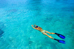 Snorkeler. Young woman ig snorkeling in tropical lagoon Stock Photo